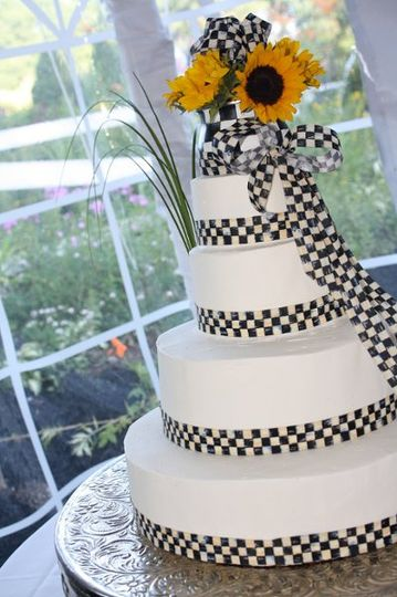 Wedding cake with sunflower on top