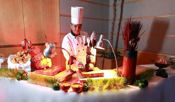 Brazilian style Churrascaria Carving Station. All meats are Fire Pit roasted and carved off Large...