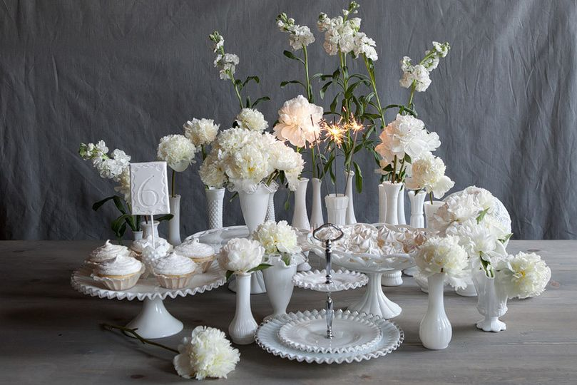 white wedding dessert table with vintage milk glass cake stands and milk glass tiered tray and milk...