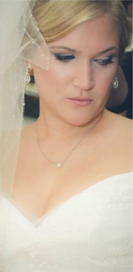Dori on her wedding day - We went for a soft smokey makeup using neutrals and plum.