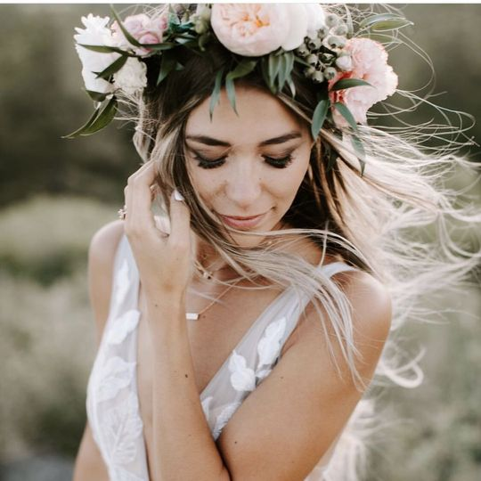 Bride wearing peach flower crown