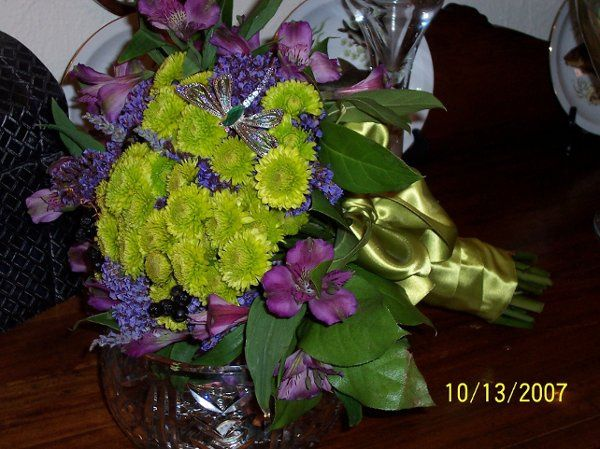 Lovely chartreuse Kermit Poms with Alstromeria and statice create a beautiful bouquet with vintage...