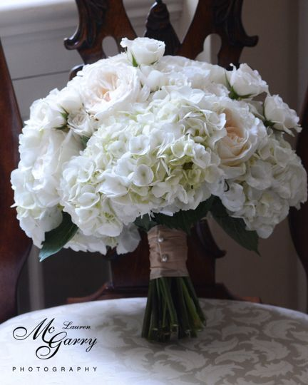 Dainty and white wedding bouquet