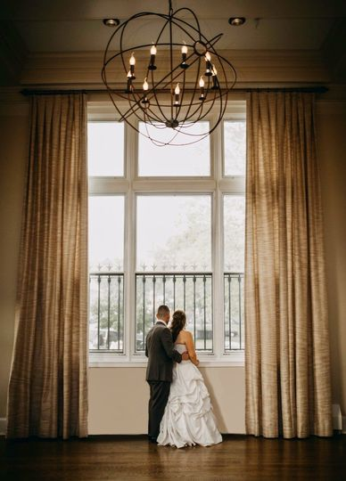 Newlyweds looking out the window
