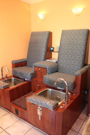 Side by side pedicure thrones.  We have the utmost standards in sanitation in our nail department....
