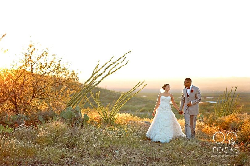 bride and groom walking in the desert at sunset tucson wedding photographer on the rocks photography wm sm 51 667835