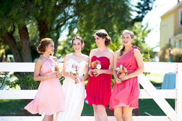Union Station bridesmaid dresses in Blush, Poppy, and Wildberry.