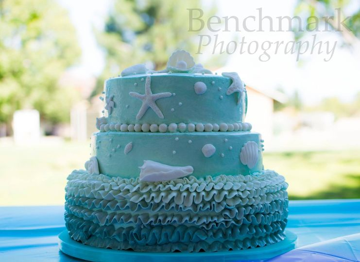 Ombre ruffle, ocean themed cake