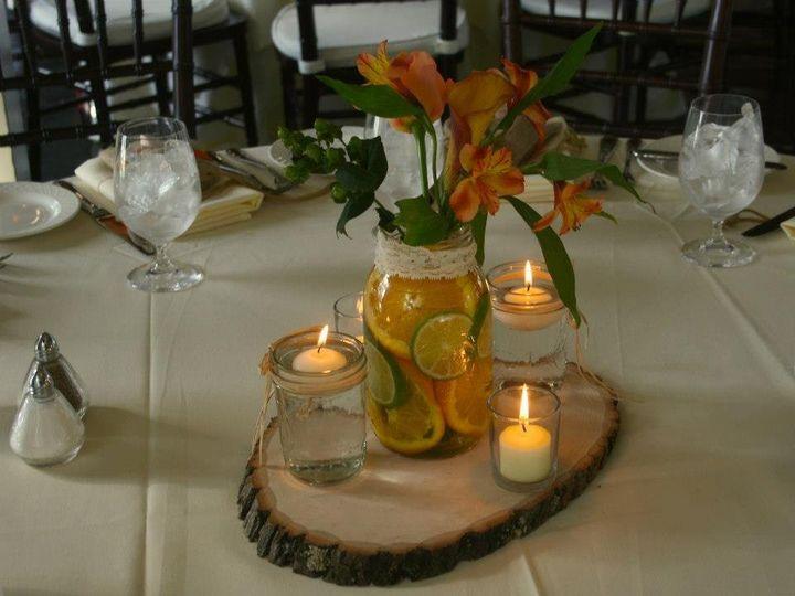 Tmx 1361299009739 AllieandToddCenterpieceonwoodslabforweddingwireII Reisterstown, MD wedding florist