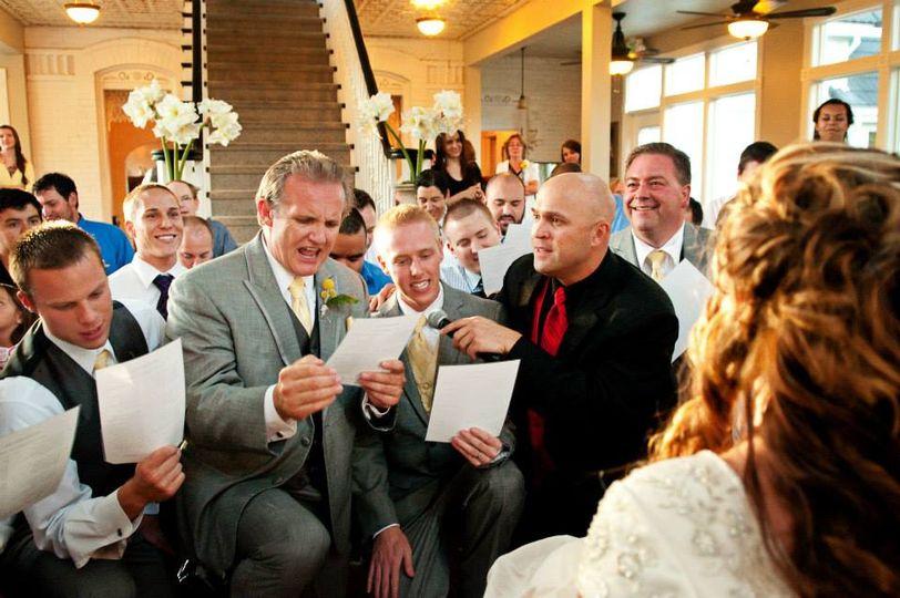 Groomsmen serenading bride
