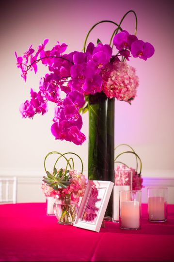 Colorful orchid and hydrangea centerpiece to add a playful vibe to this imaginative affair.