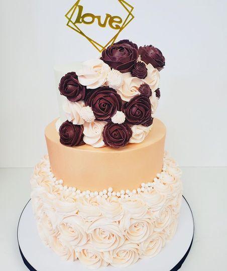 Blush and burgundy rosette cake