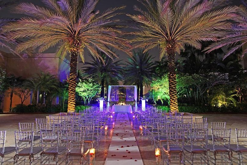 5bef4cf8991b46ee 1414679706788 palm court night shot with chairs