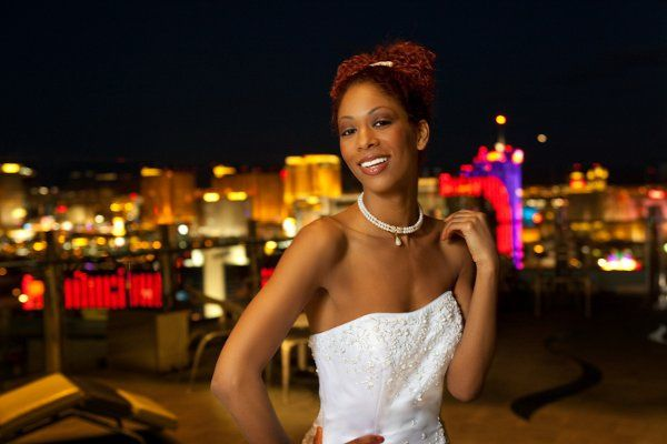 Bride on the rooftop of a hotel overlooking the Las Vegas Strip
