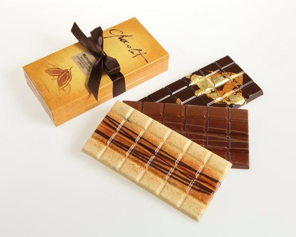 Three unique hand-painted chocolate bars (Vanilla pearl, Mahogany, Caracas).