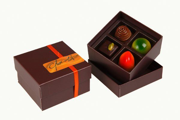 A selection of 4 artisan chocolates from our creations in elegant custom-designed packaging.