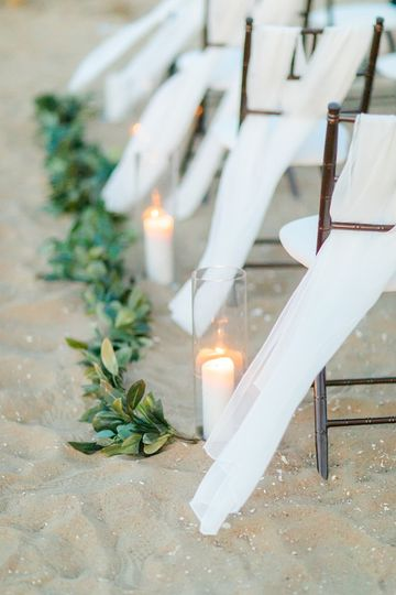 Aisle candles and greenery