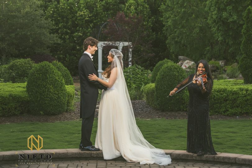 Violinist playing for the couple