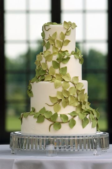 """AP Signature Cakes Collection """"Nature"""" White tiers embellished with trailing fondant vines and..."""