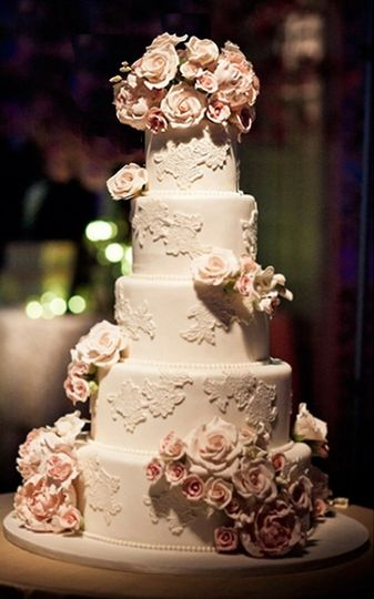 Ana Parzych Custom Cakes  Round tiers featuring fondant pressed lace, fondant molded pearl border...