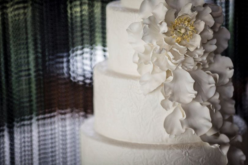 "AP Signature Cakes Collection ""Windswept""  Textured fondant tier with oversized sugar bloom and..."