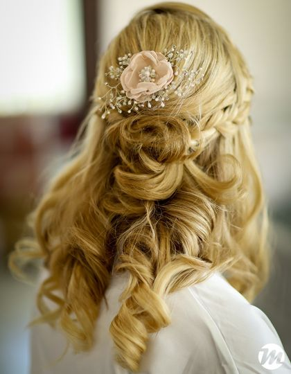 Braided bridal half up hairstyle with accessory
