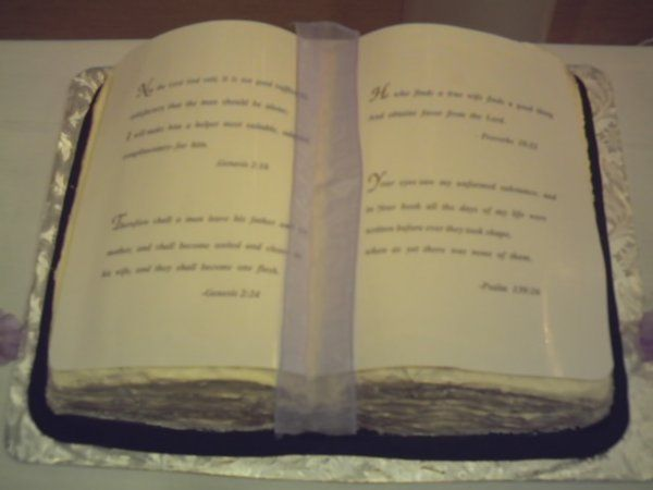 Open Bible shape Grooms cake,with pre-printed scriptures and ribon layed on top.(Can't forget the...