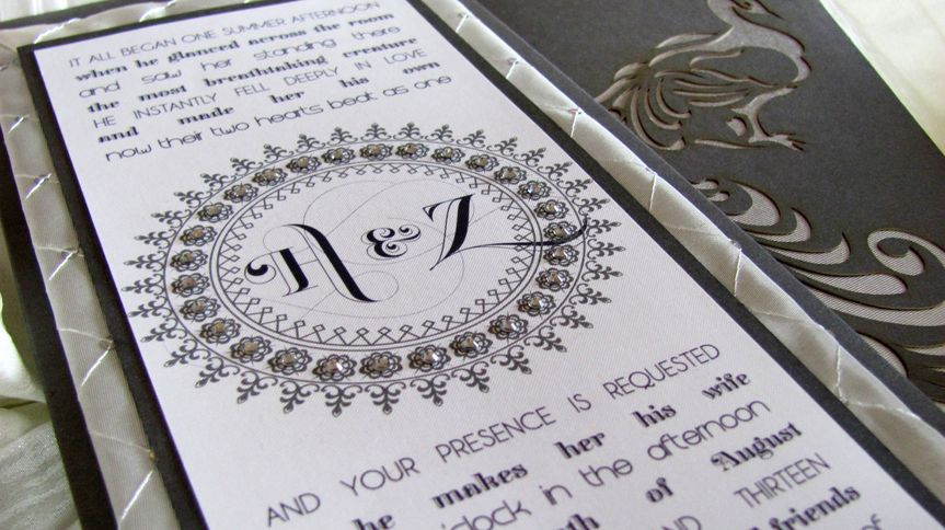 Couture invitations are handcrafted with fine materials of varying textures, and include special...