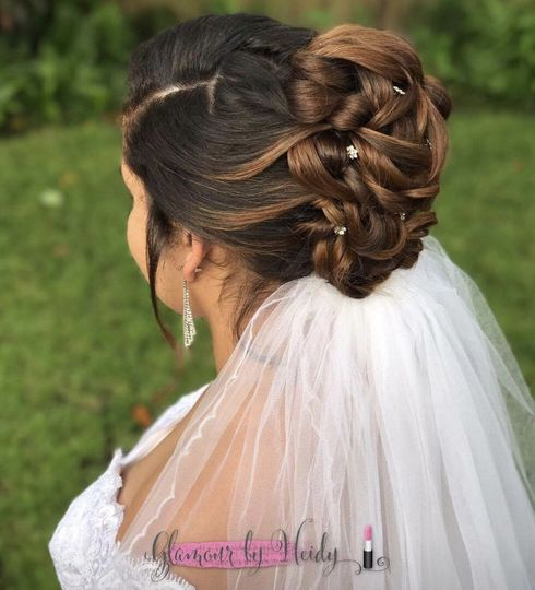 Intricate braids over bridal veil