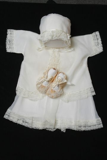 Baby Christening Dress after Restoration by National Gown Cleaners. LLC