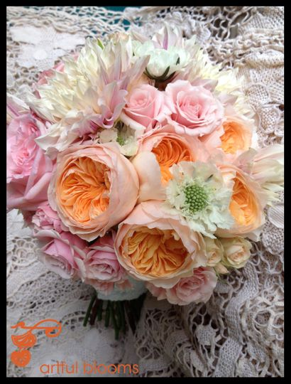 Playful and bright bouquet with coral & red dahlias, snapdragons, hot pink crested celosia and...