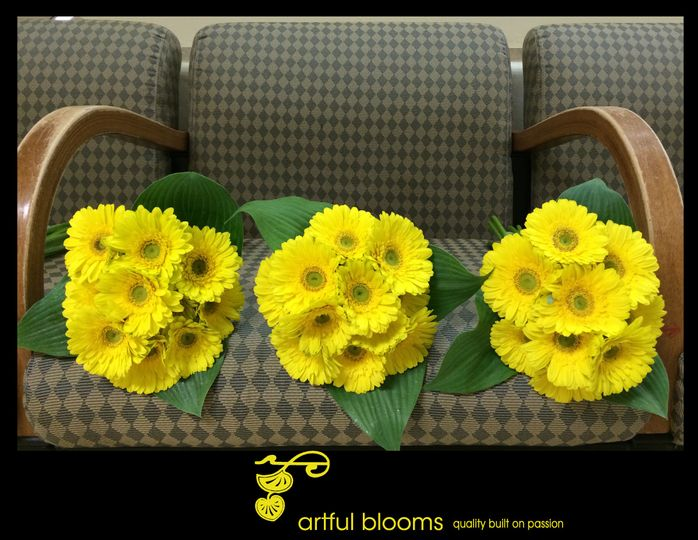 Modern, timeless design of canary yellow gerberas with leaf collars