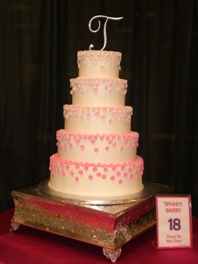 White wedding cake with a touch of pink