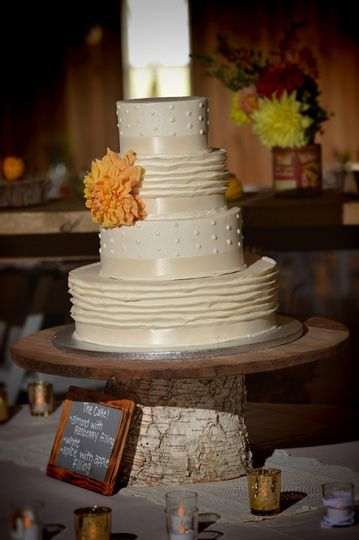 Wedding cake with a yellow flower