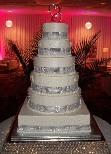 White wedding cake with silver ribbon