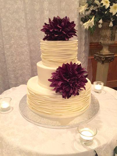 Wedding cake with deep purple flowers