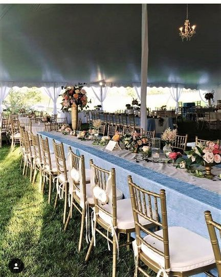 Blue ice crinkle tablecloth and gold chiavari chairs