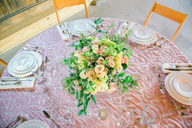 Blush athena tablecloth, hollywood natural folding chairs, and dinnerware