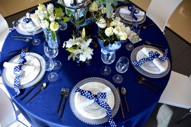 Black flatware, platinum dinner plates, and glass ridged