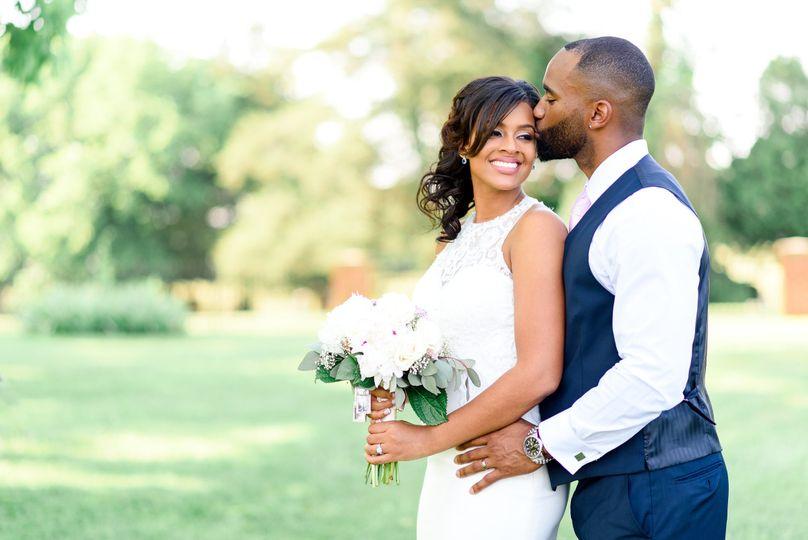 Kiss the bride Alina Thomas, Senior Photographer considers herself a wedding photographer with a...