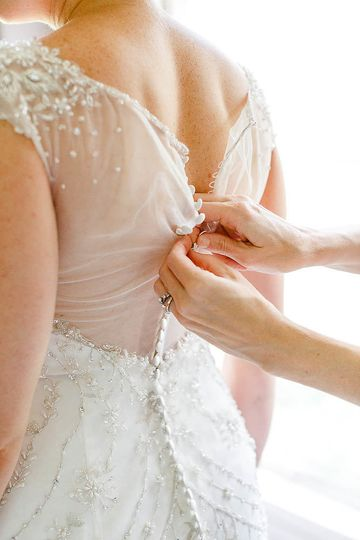 Helping the bride Alina Thomas, Senior Photographer considers herself a wedding photographer with a...