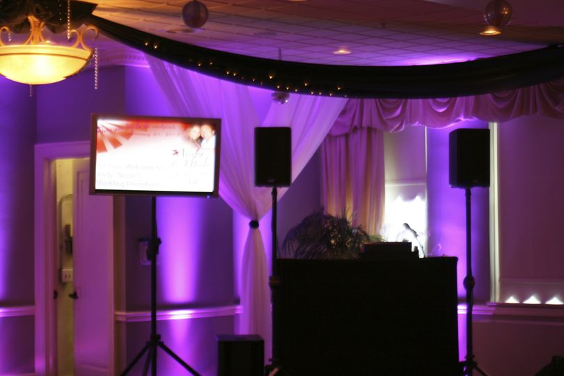 DJ station with purple uplighting
