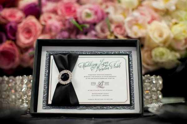 Coco Chanel invitation in a box with rhinestone buckle