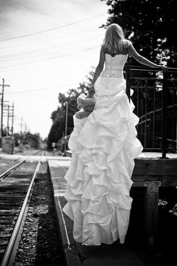 On the cusp of change, this bride found inspiration on the railroad. Black and white with vertical,...