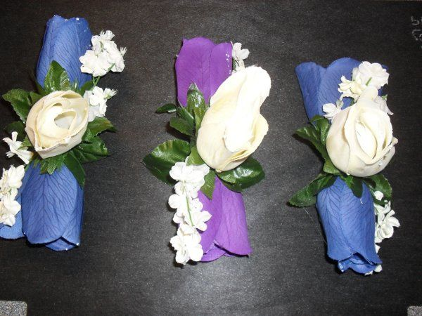 wedding 1/11/2011  Three corsages. Two blue for the mothers, one purple for the friend of the bride.