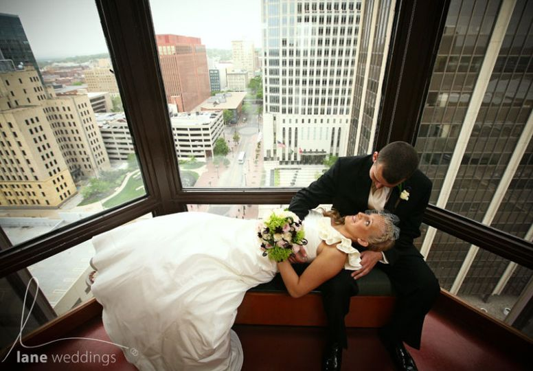 Newlyweds by the windows