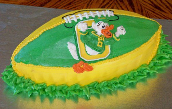 """Groom's cake for a University of Oregon fan.  3D cake football with """"fighting duck"""" mascot."""