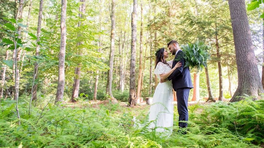 Wedding couple and ferns