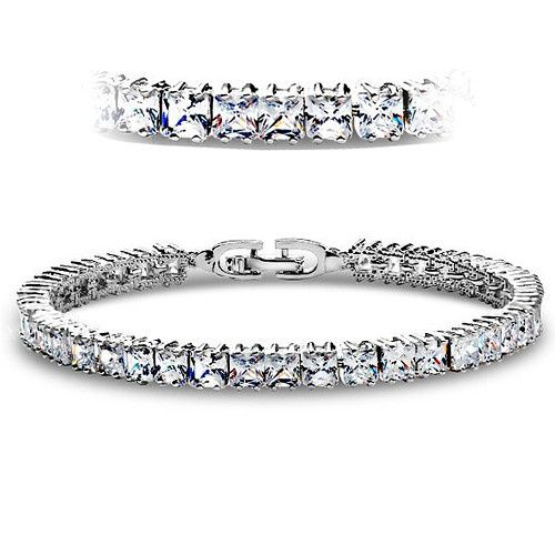 """Genuine white gold plated traditional tennis bracelet with Princess cut crystals.  Standard 7""""inch..."""