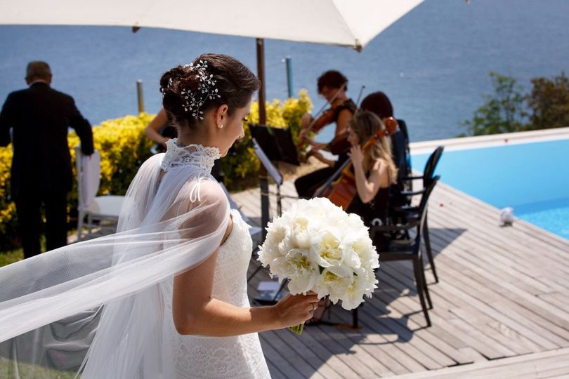 Classical string quartet performing at a wedding ceremony in Arenzano.Wedding by Glam Events in...